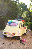 Newlywed's car decorated with balloons